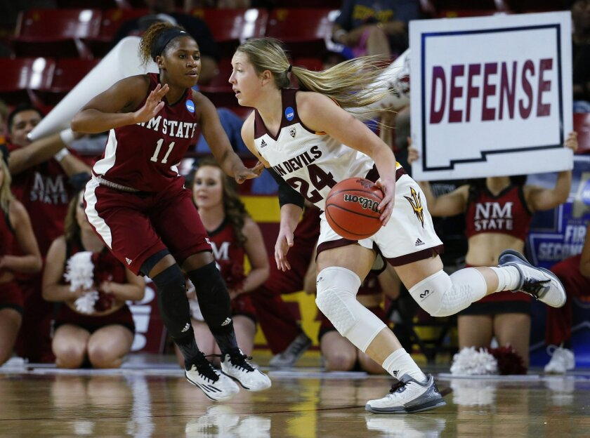 Arizona State forward Kelsey Moos (24) drives against New Mexico State guard Shanice Davis (11) during the first half of a first-round women's college basketball game in the NCAA Tournament, Friday, March 18, 2016, in Tempe, Ariz. (AP Photo/Matt York)