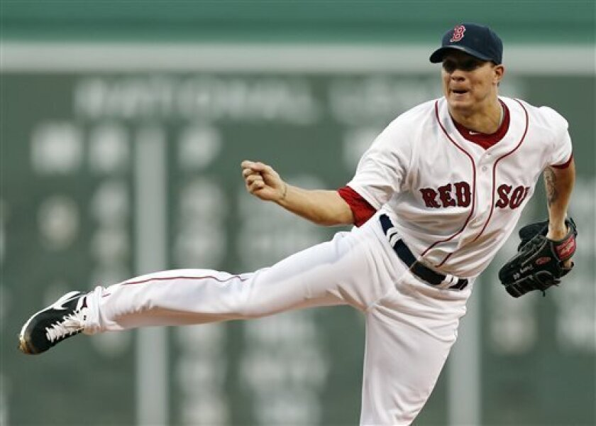 Boston Red Sox's Jake Peavy pitches in the second inning of a baseball game against the Arizona Diamondbacks in Boston, Saturday, Aug. 3, 2013. (AP Photo/Michael Dwyer)