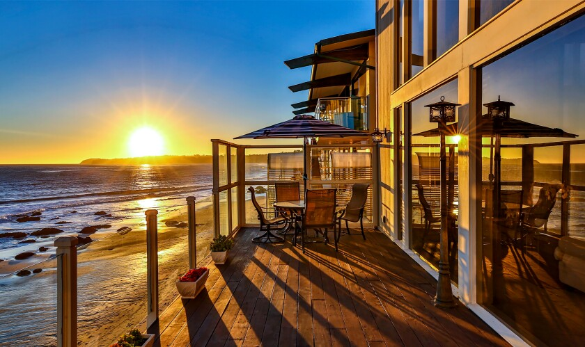 """Barry Williams of """"The Brady Bunch"""" fame has sold his home in the Malibu Cove Colony community for $5.82 million. The oceanfront spread features a two-story living room, a rock fireplace and walls of windows that take in the surf."""