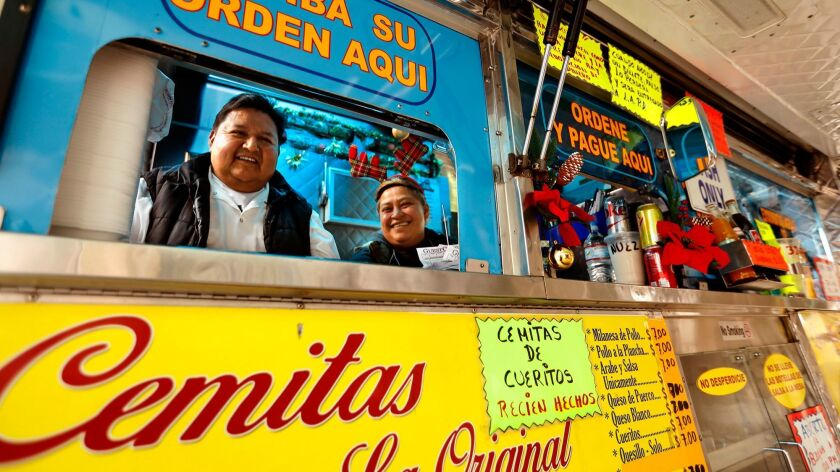 LOS ANGELES, CA - DECEMBER 20, 2017 -- Juan Andrade, owner of Cemitas Los Poblanos food truck, and L