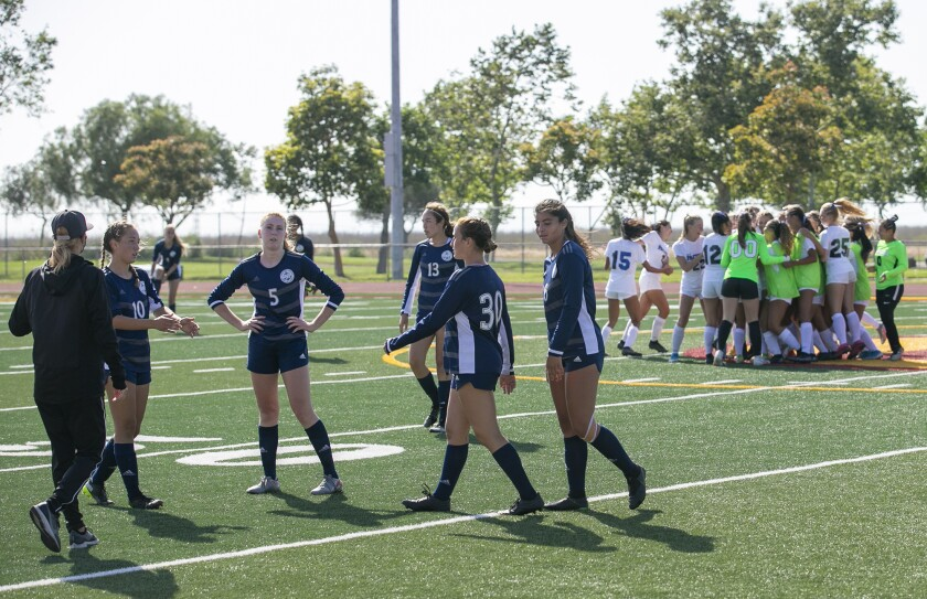 Newport Harbor's team gathers following a loss to Pacifica in the  CIF Southern Section Division 1 playoffs on Friday.