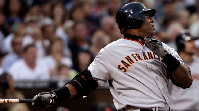 The Giants' Barry Bonds watches the flight of his home run, his 755th, during the second inning of their Major League Baseball game against the San Diego Padres in San Diego, Saturday, Aug. 4, 2007. With the hit, Bonds caught Hank Aaron and tied the career home run record.