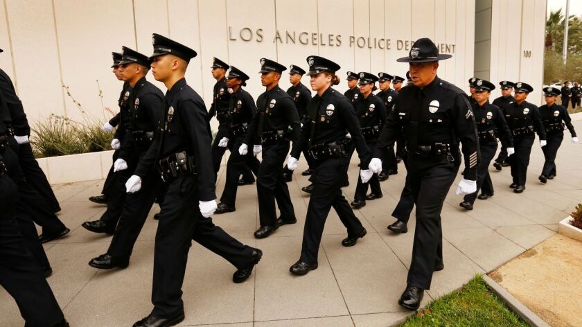 New Los Angeles police officers walk into a graduation ceremony in 2016.