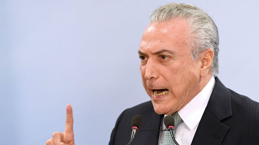 TOPSHOT - Brazil's President Michel Temer speaks during a press conference following allegations tha