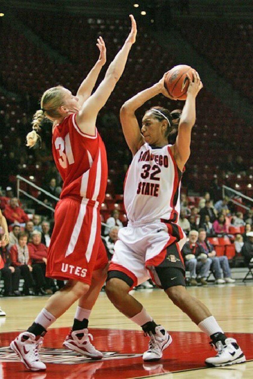 SDSU's Paris Johnson (No. 32) wears  the same number worn by her sister,  Desiree, who played for SDSU from  2005-07. (Sean M. Haffey / Union-Tribune)