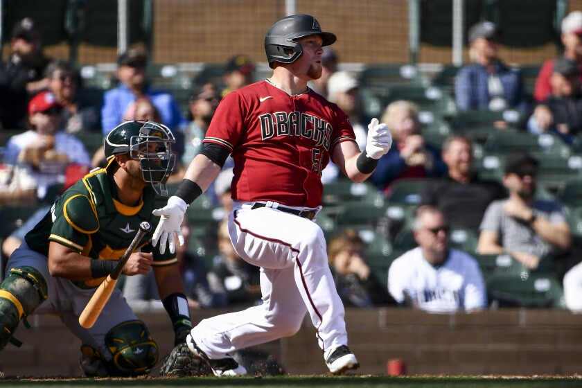 Arizona Diamondbacks outfielder Kole Calhoun hits a sacrifice fly against the Oakland Athletics on Feb. 23.