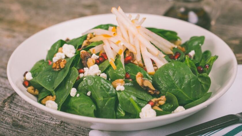 Rustic Root is serving a seasonal dishes like spinach and pear salad.