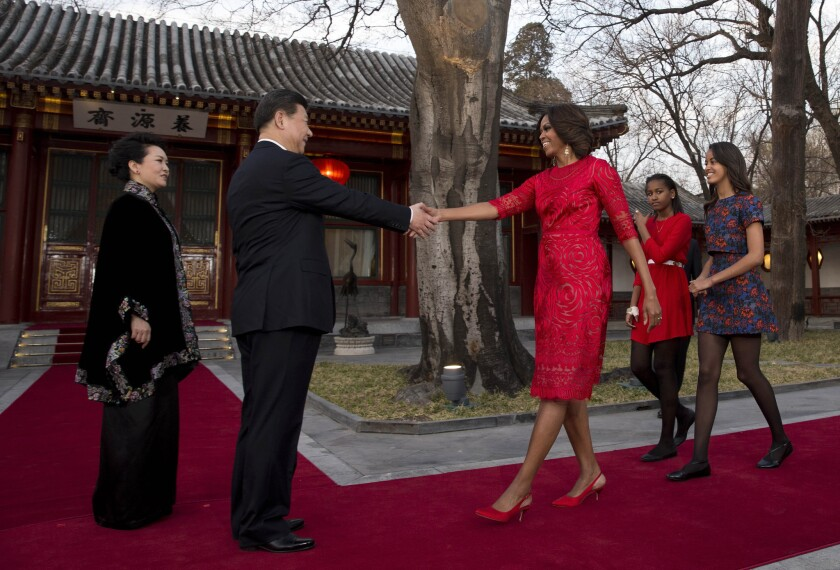 First Lady Michelle Obama, with daughters Malia, right, and Sasha, is greeted by Chinese President Xi Jinping and his wife, Peng Liyuan, at the Diaoyutai State Guesthouse in Beijing.
