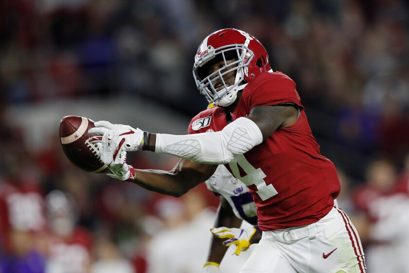 Alabama receiver Jerry Jeudy reaches for a pass against Louisiana State in November.