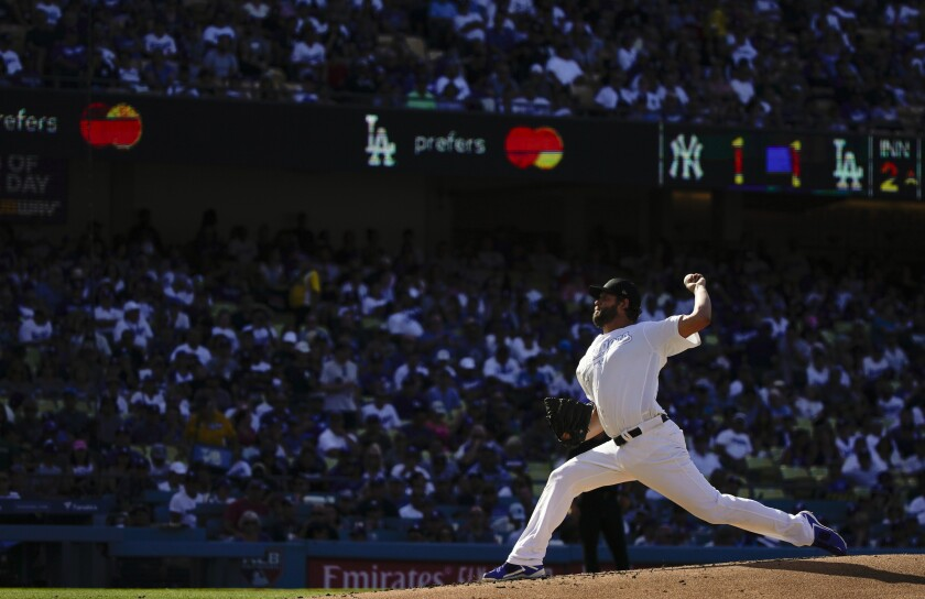 Dodgers starter Clayton Kershaw delivers against the New York Yankees on Sunday.
