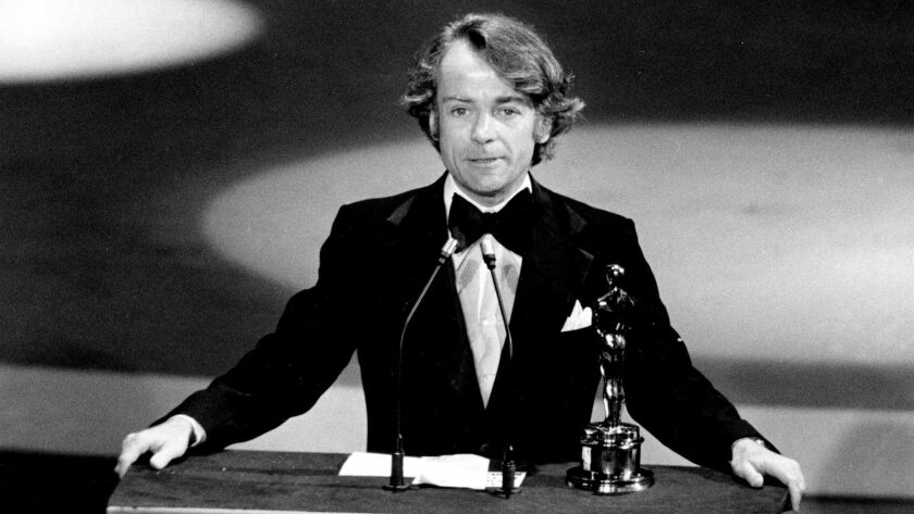 FILE - In this March 28, 1977, file photo, John G. Avildsen accepts the Oscar for best director for