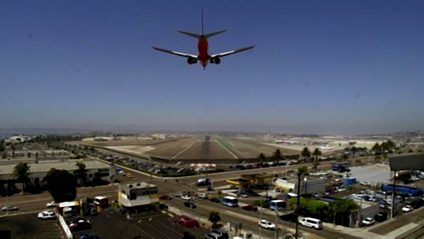 A plane descends for landing at San Diego International Airport.