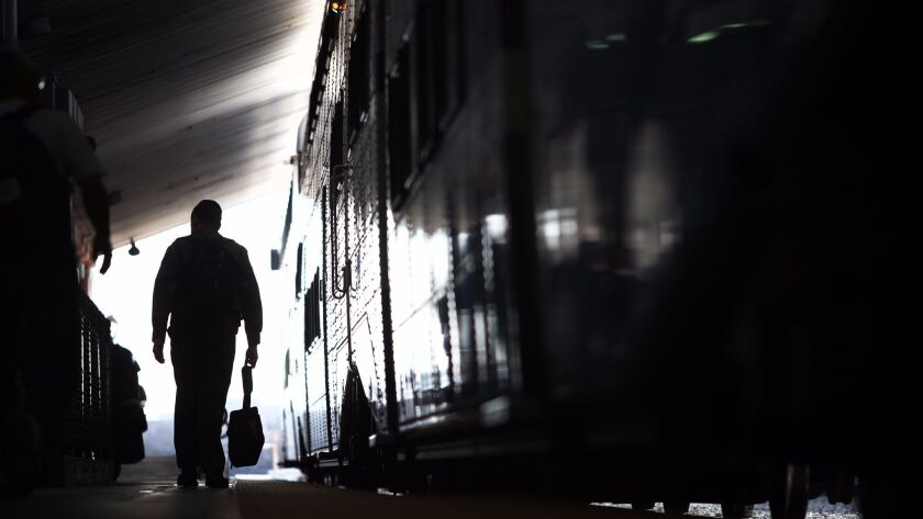 LOS ANGELES, CA. -- THURSDAY, FEBRUARY 20, 2014 -- A commuter walks the platform at Union Station w