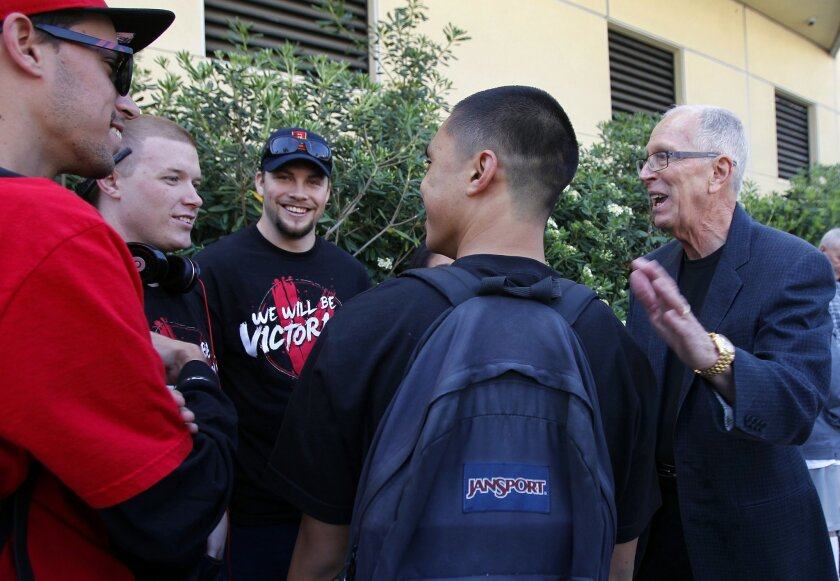 """SDSU basketball coach Steve Fisher greeted members of """"The Show"""" as the team boarded a bus to the airport on their way to the NCAA tournament in Columbus, Ohio  on Wednesday, March 14, 2012."""
