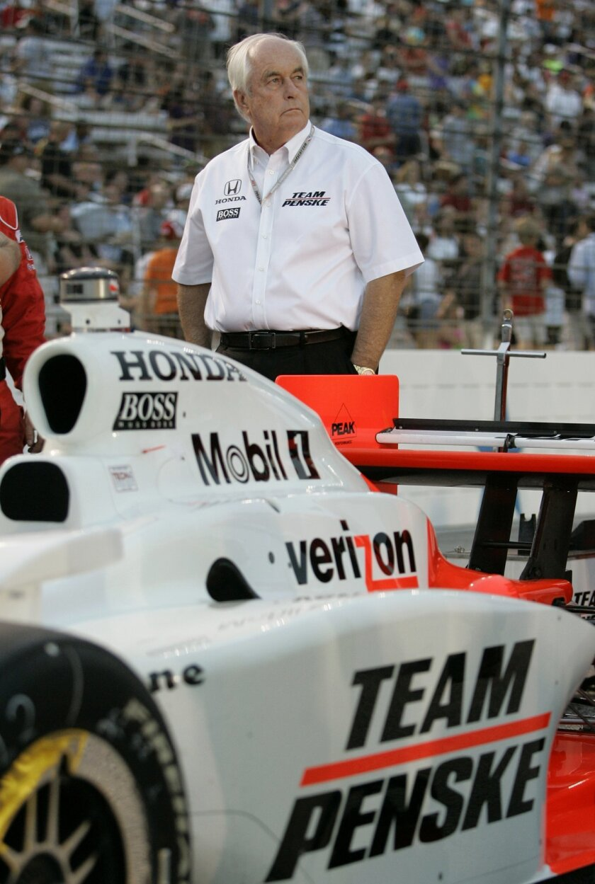 """FILE - In this June 6, 2009, file photo, team owner Roger Penske stands near the car that Ryan Briscoe drove, before an IndyCar Series auto race at Texas Motor Speedway in Fort Worth, Texas. In the lead-up to the 100th running of the """"The Greatest Spectacle in Racing,"""" The Associated Press intervie"""