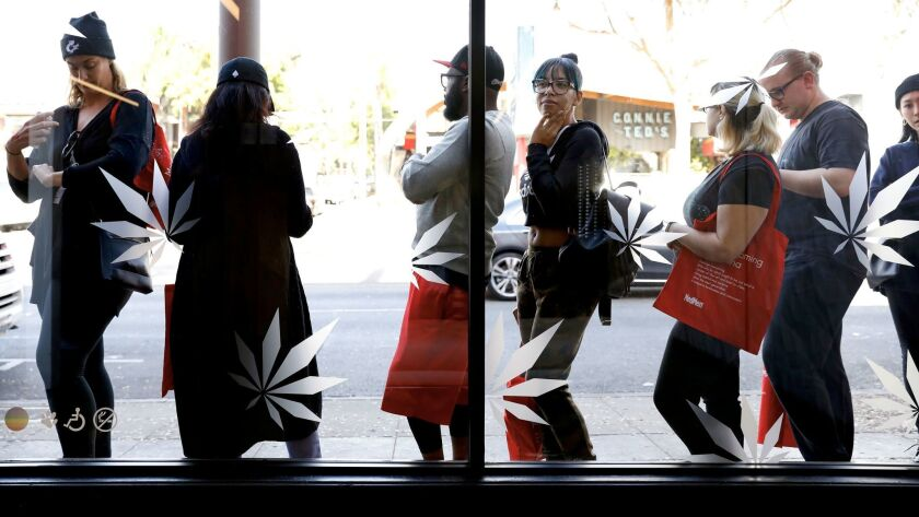Customers line up outside MedMen dispensary on the first day of recreational marijuana sales in West Hollywood.