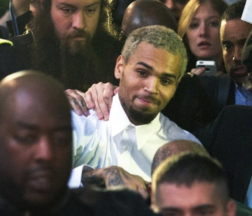 Singer Chris Brown departs the H. Carl Moultrie Courthouse last month in Washington, D.C.