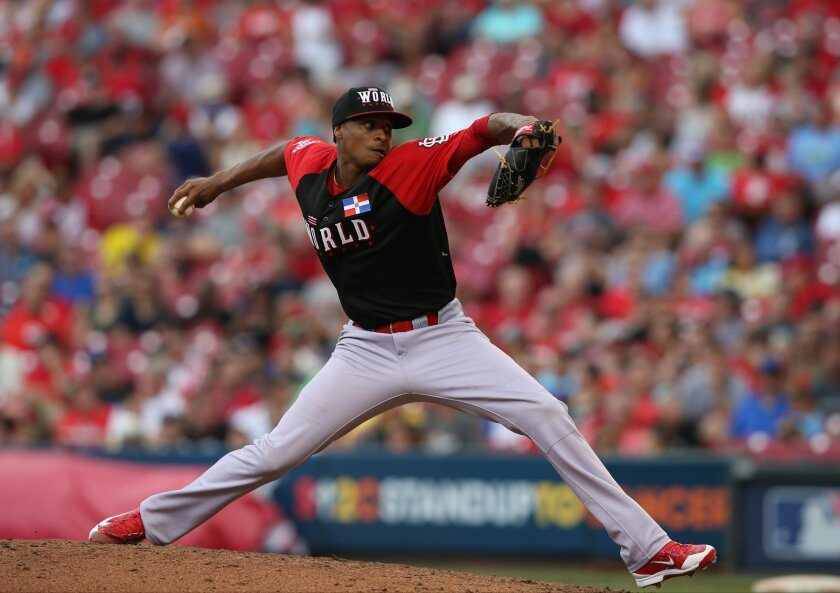 World's Luis Perdomo throws during the eighth inning of the All-Star Futures baseball game against Team United States, Sunday, July 12, 2015, in Cincinnati.