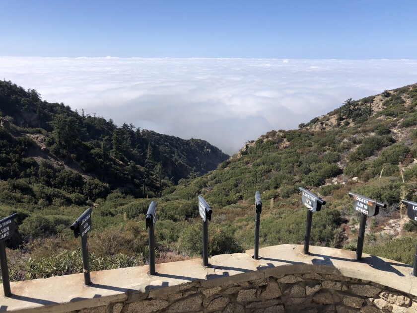 Photo of puffy clouds blocking the view from Inspiration Point above Altadena.