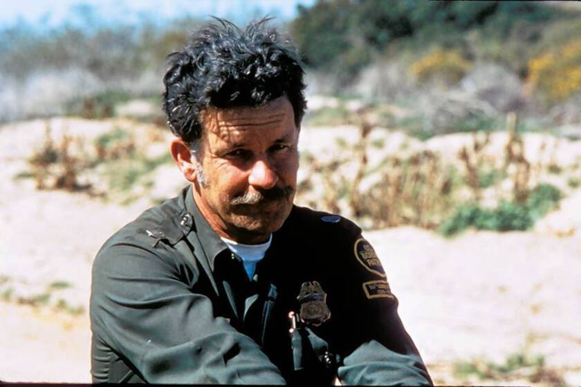 Ab Taylor, shown in 1975, tracked innumerable immigrants and also helped capture killers and kidnappers and find lost children.