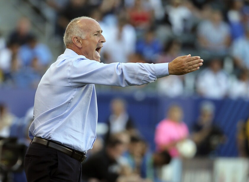 Dominic Kinnear shouts from the sideline while coaching for the Galaxy on Sept. 23, 2018, against Seattle.