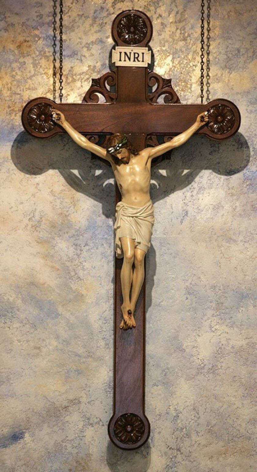 Slightly damaged, this 82-year-old crucifix was restored to St. Didacus. (Nancee E. Lewis / Union-Tribune)