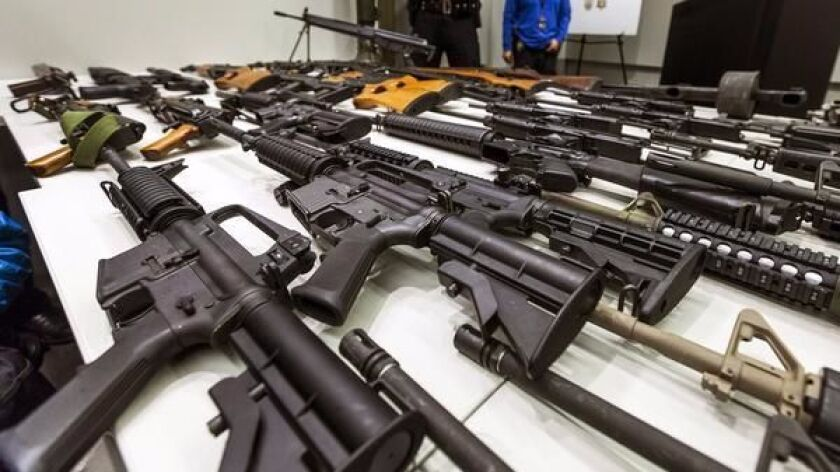 FILE - In this Dec. 27, 2012, file photo, a variety of military-style semi-automatic rifles obtained during a buy back program are displayed at Los Angeles police headquarters.