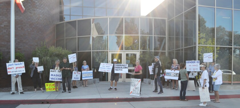 Protestors outside the Poway Unified School District office June 3 carried signs against critical race theory