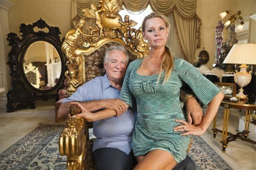 """This image released by Magnolia Pictures shows David Siegel, left, and Jackie Siegel, subjects of the documentary """"The Queen of Versailles."""" (AP Photo/Magnolia Pictures, Lauren Greenfield)"""