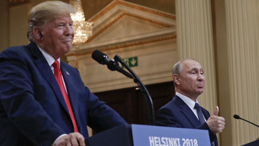 Russian President Vladimir Putin and President Trump give a joint news conference in Helsinki, Finland, on July 16.