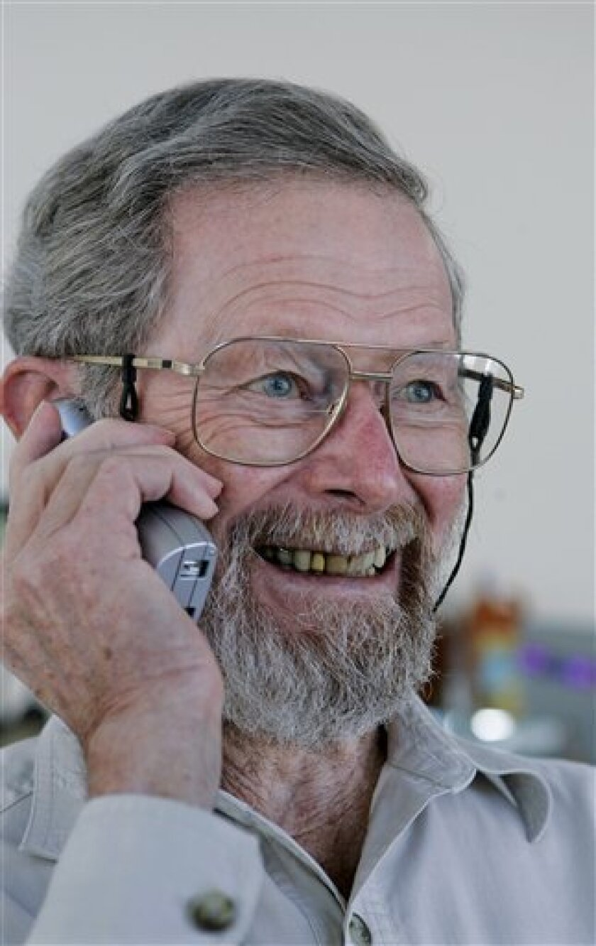 George E. Smith, 79, receives a congratulatory telephone call at his home in Waretown, N.J., Tuesday, Oct. 6, 2009, after it was announced that he had won the Nobel Prize in physics. Smith along with Willard S. Boyle, 85, were honored for inventing the eye of the digital camera, a sensor able to transform light into a large number of pixels, the tiny points of color that are the building blocks of every digital image. (AP Photo/Mel Evans)
