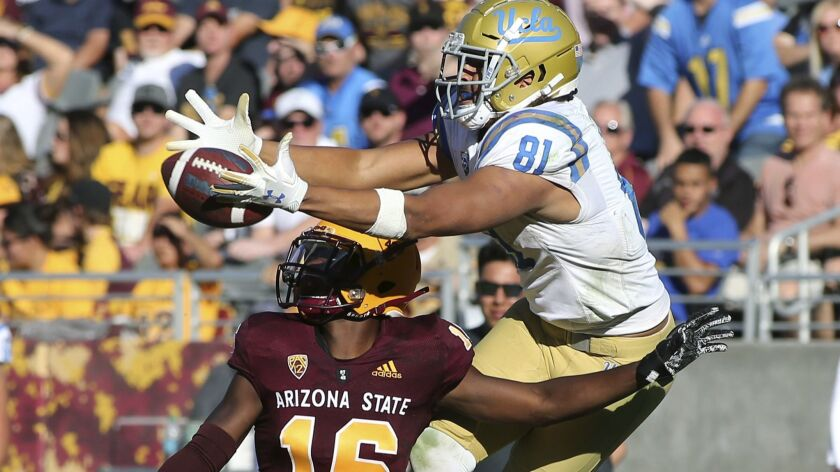 UCLA tight end Caleb Wilson leaps to catch a pass over Arizona State defensive back Aashari Crosswell during the second half. Wilson had season highs with 11 receptions, 164 yards and two touchdowns.