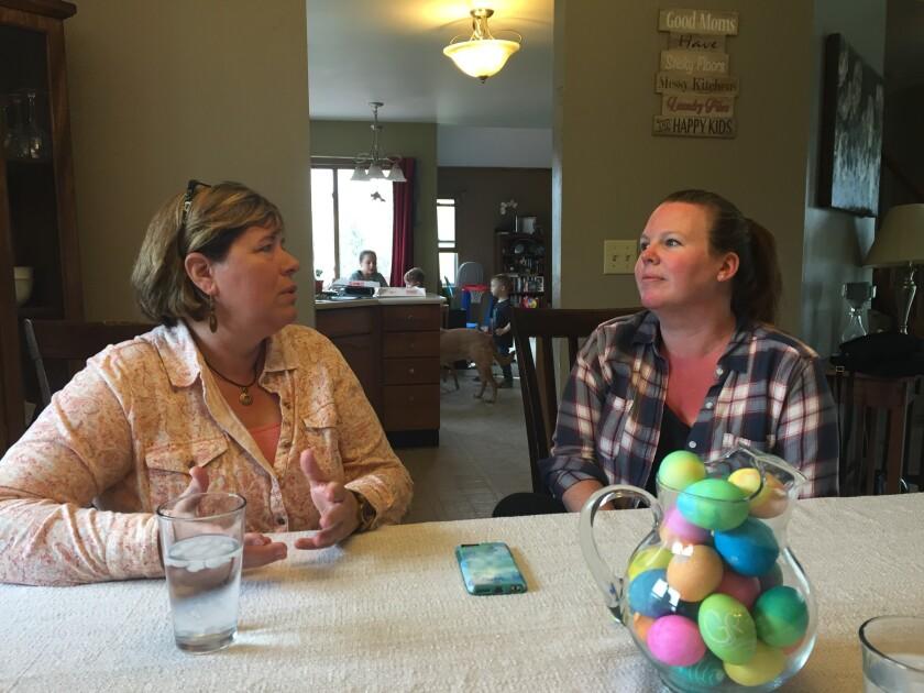 Jodi Muerhoff, left, and Julia Kozel organized a Trump resistance group in Kenosha, Wis.