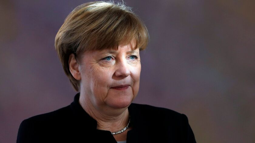 German Chancellor Angela Merkel looks on as she attends the official act for the appointment of new ministers at Bellevue Palace in Berlin, Germany, on Jan. 27.