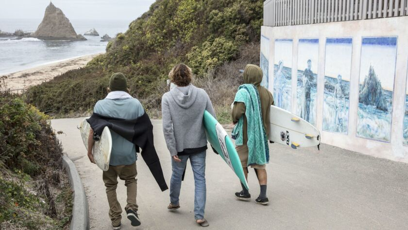 An unidentified local surfers makes their way down to Martins Beach on the day Surfrider Foundation?