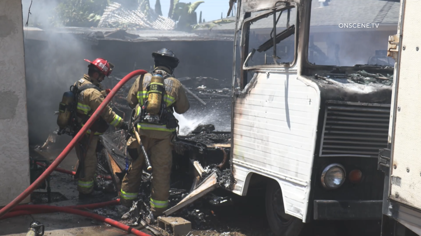 Firefighters responded to an RV fire that spread to a home in Spring Valley on Tuesday.