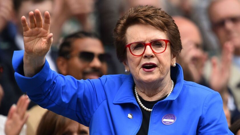 Tennis legend Billie Jean King waves to fans at the All England Tennis Club in Wimbledon on July 6. King says FIFA needs to do the right thing and require equal pay for women's soccer players.