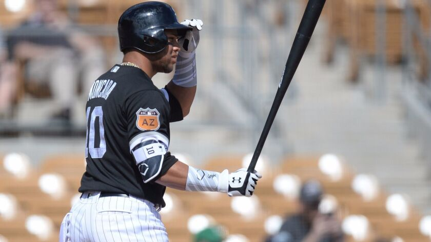 Chicago White Sox second baseman Yoan Moncada (10) bats in the second inning against the Seattle Mariners at Camelback Ranch.