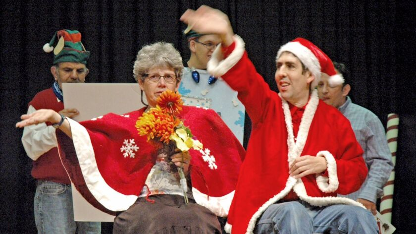 """JoEllen Bosset and Joseph Vartanian play Mr. And Mrs. Santa Claus in the annual Holiday Program produced by BCR """"a place to grow."""""""