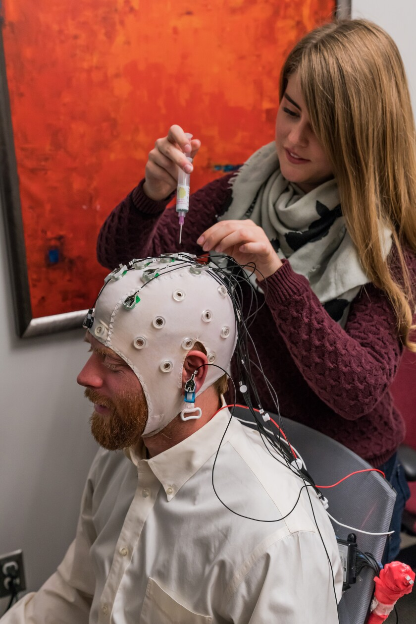 Researchers at the University of Utah prepare for an electroencephalogram test to see whether mindfulness techniques helped people overcome their addiction to opioids.