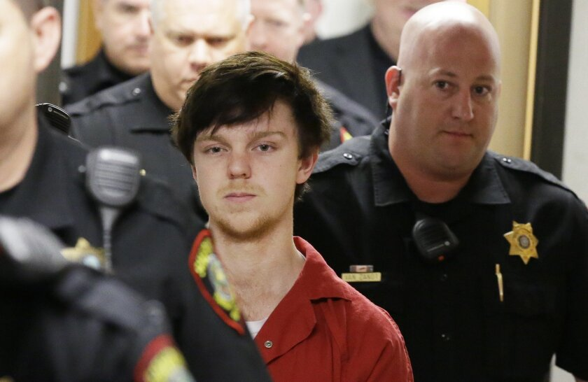 "Ethan Couch is led by sheriff deputies after  a juvenile court for a hearing Friday, Feb. 19, 2016, in Fort Worth, Texas.  A Texas judge ruled Couch, who used an ""affluenza"" defense in a fatal drunken-driving wreck will be moved to adult court, meaning the teen could face jail time for the 2013 wre"