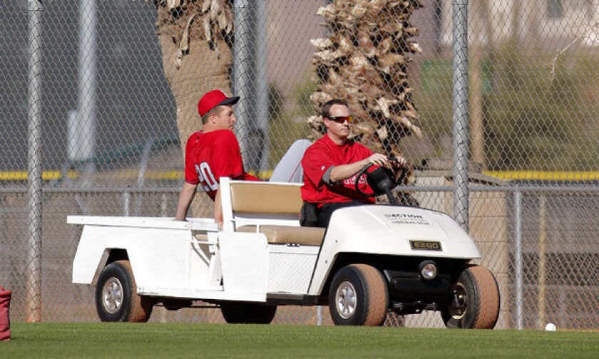 Angels pitcher Mark Mulder is carted off the field after suffering a ruptured left Achilles' tendon during a spring training session in Tempe, Ariz., on Saturday.