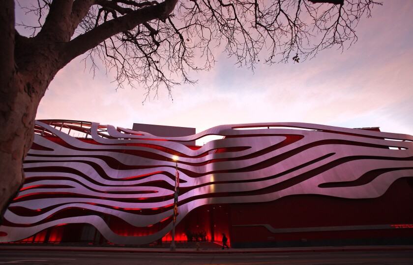 The Petersen Automotive Museum and its controversial facade glows at dawn in Los Angeles.