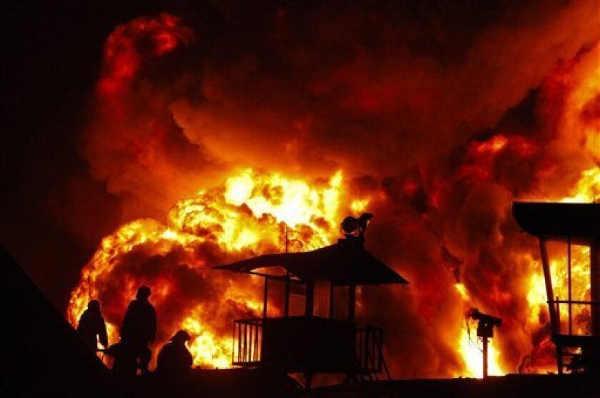 """Indonesian firefighters battle a massive fire at one of Jakarta's largest fuel terminals early Monday Jan. 19, 2009 in Jakarta, Indonesia.  It was unclear what started the fire, but """"explosions were heard from the tank,"""" said Afendi, a worker at the Pertamina national oil company which operates the"""