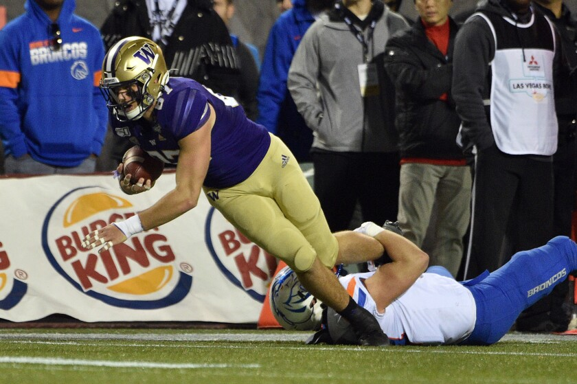 Washington's Cade Otton dives for extra yardage against Boise State during the Las Vegas Bowl on Saturday.