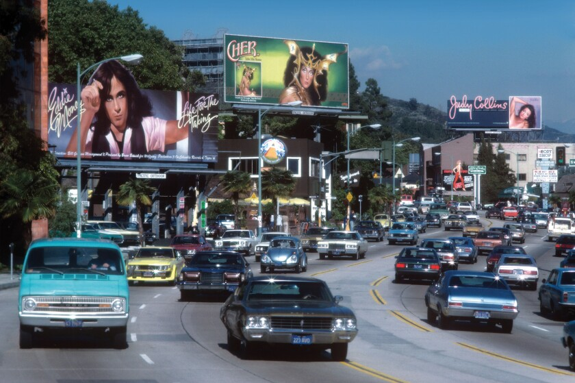 """Eddie Money, Cher and Judy Collins, late 1970s, as seen in """"Rock 'N' Roll Billboards of the Sunset Strip."""""""