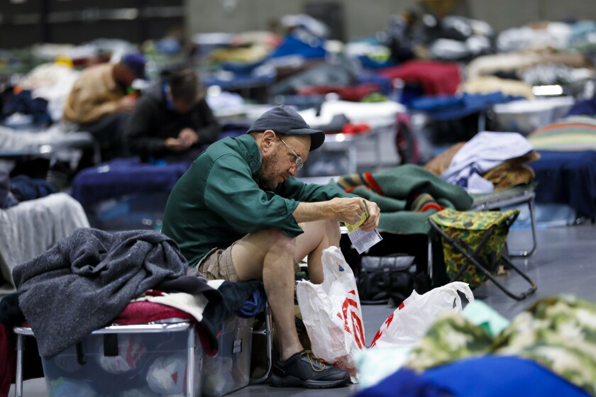 Tom Shelley is among the 829 homeless men and women that have been sheltered in the temporary shelter set up at the San Diego Convention Center.