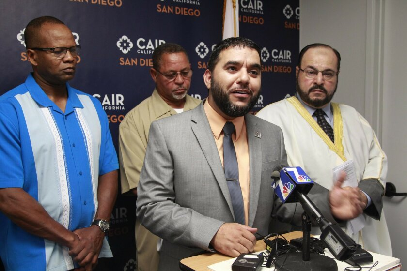 The San Diego Office of the Council on American-Islamic Relations held a press conference to denounce ISIS extremists. Hanif Mohebi, executive director of the San Diego Chapter explained their action from the podium. In the rear, l-r, are Adib K. Mahdi, representing Pillars of the Community, Imam Wali Fardan, from the Mosque Taqwa on Imperial Avenue, and Imam Sharif Battkiki from the American Islamic Services Foundation.