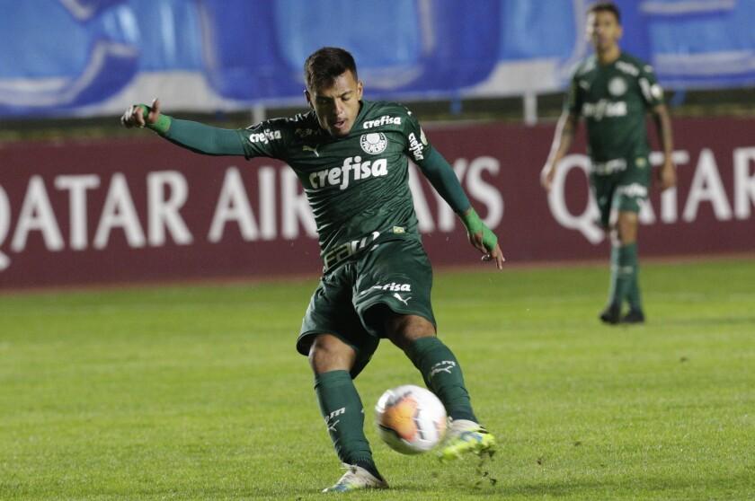 Gabriel Menino of Brazil's Palmeiras kicks the ball during a Copa Libertadores soccer match against Bolivia's Bolivar in La Paz, Bolivia, Wednesday, Sept. 16, 2020. (David Mercado/Pool via AP )