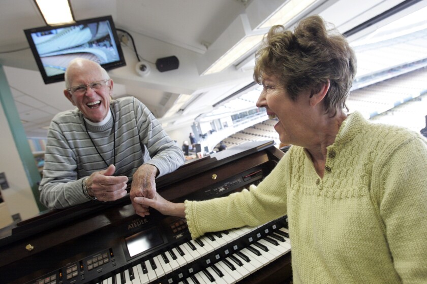 Dodgers organist Nancy Bea and husband Billy Hefley before a game on April 13, 2012.